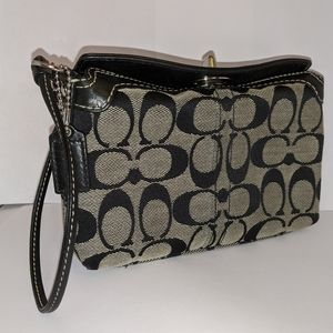 Black fabric and leather coach wristlet